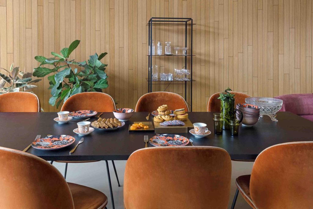 Warm orange tone dining chairs upholstered in fibreguard fabrics